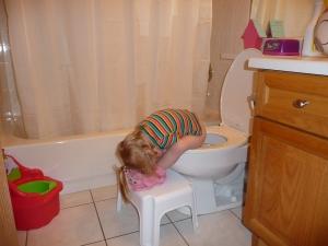 Child asleep on toilet